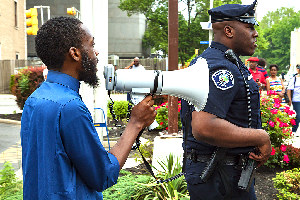 Man-with-bullhorn-giving-cop-hell-on-5-18-15--Camden