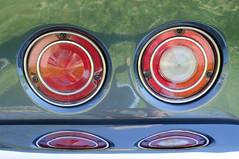 automotive exterior(0.0), wheel(0.0), gauge(0.0), rim(0.0), steering wheel(0.0), bumper(0.0), spoke(0.0), automotive lighting(1.0),