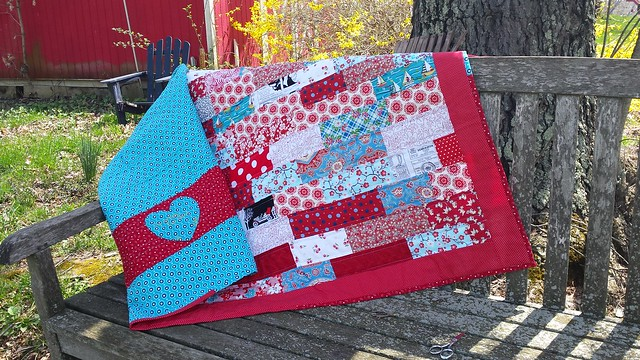 Red subway tile scrap quilt finished!  I love how this came out so much more than I thought I would (I was apprehensive about using reds).