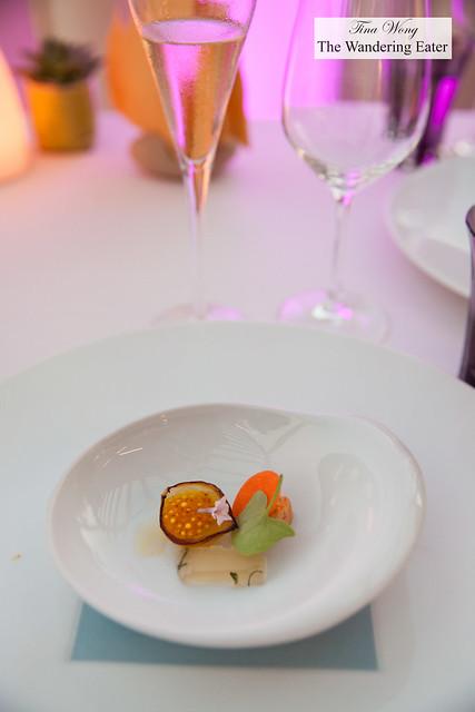 Amuse bouche of pearl onion petal, tomato water jelly