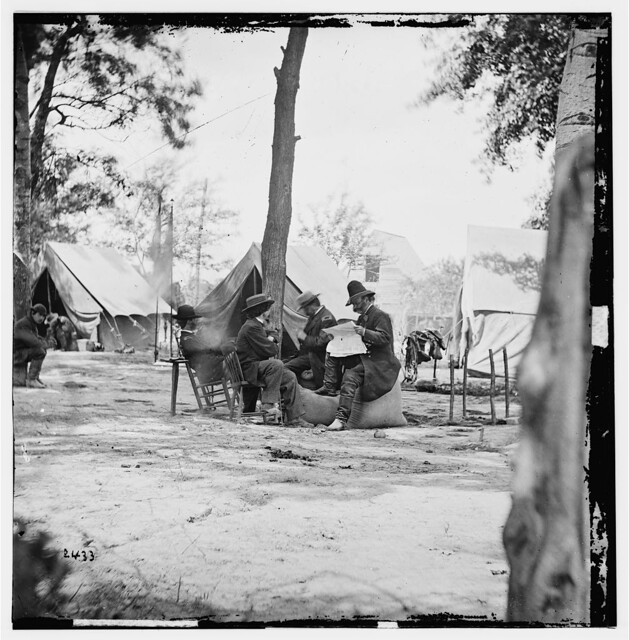General Ambrose E. Burnside (reading newspaper) with Mathew B. Brady (nearest tree) at Army of the Potomac Headquarters - Newell F. Hill served under Burnside