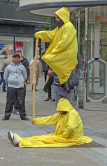 hazmat suit(0.0), construction worker(0.0), yellow(1.0), cleanliness(1.0),