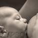 Young Mother Breast Feeding Her Newborn Baby Boy