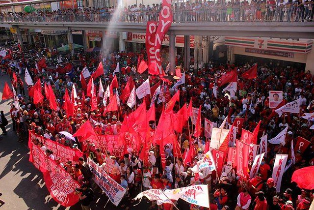 Kilusang Mayo Uno unionists in the Philippines march for May Day