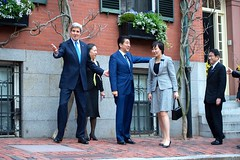 U.S. Secretary of State John Kerry leads Japanese Prime Minister Shinzo Abe and his wife, Akie Abe, as well as Japanese Foreign Minister Fumio Kishida, toward his home on Beacon Hill in Boston, Massachusetts, on April 26, 2015, before a working dinner at the outset of the Abes' weeklong State visit to the United States. [State Department photo/ Public Domain]