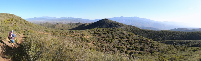 Panorama view north and east as we hike down and down into the desert. San Jacinto and Toro Peaks are in the distance
