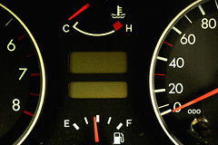 odometer(0.0), automotive exterior(0.0), wheel(0.0), rim(0.0), steering wheel(0.0), vehicle registration plate(0.0), vehicle(1.0), gauge(1.0), font(1.0), speedometer(1.0),