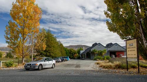 autumn trees newzealand sky cars clouds buildings landscape vineyard autumncolours southisland bannockburn wineregion tripanzacblipmeetcentralotago carrickwiney