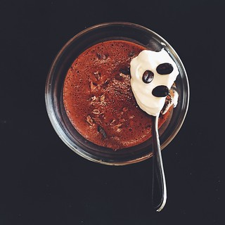 Espresso-chocolate mousse with cacao nibs, with whipped cream and coffee beans