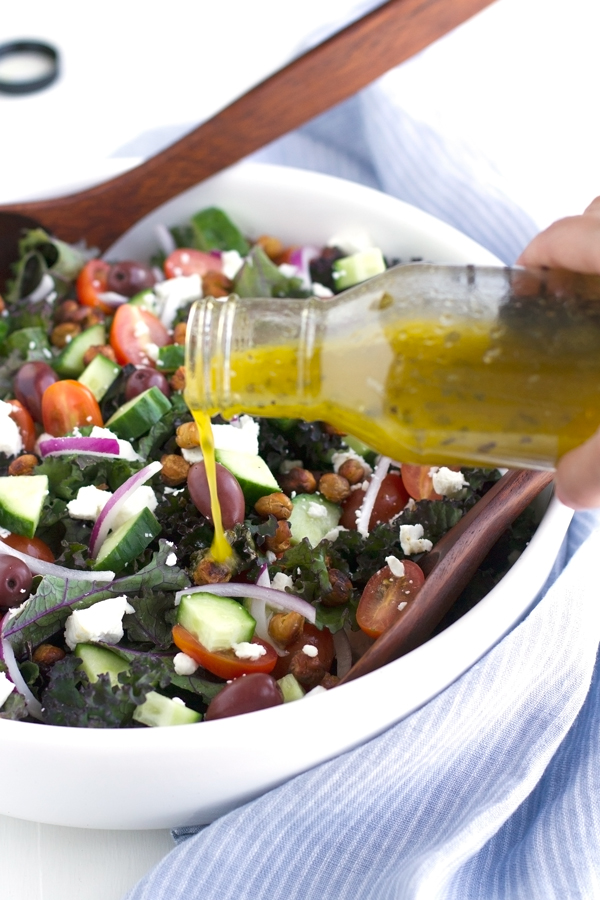 Kale Greek Salad with Roasted Chickpea Croutons - this salad it loaded with so much flavor. Drizzled with lemon vinaigrette. SO GOOD! #greeksalad #kalesalad #roastedchickpeas   Littlespicejar.com