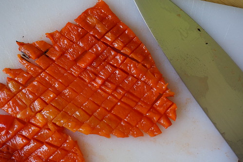 Close up shot of a roasted red pepper sliced in a neat grid