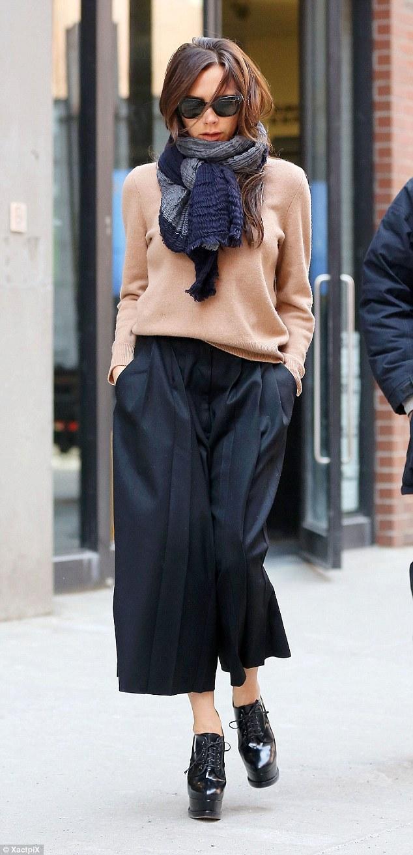 black-pleated-culottes-beige-sweater-chunky-scarf-high-heeled-platform