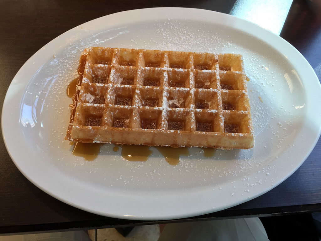 Large waffle with maple syrup