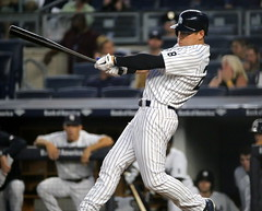 The Yankees' Jacoby Ellsbury swings at a pitch in the first inning.