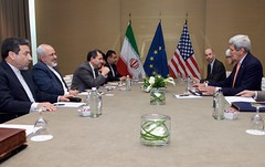 U.S. Secretary of State John Kerry sits across from Iranian Foreign Minister Javad Zarif as they settle into a meeting room in Geneva, Switzerland, on May 30, 2015, for the latest round in the P5+1 negotiations about the future of Iran's nuclear program. [State Department Photo/ Public Domain]