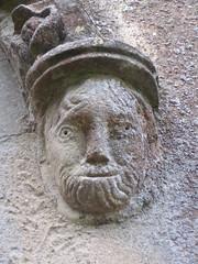 Corbel head flanking window