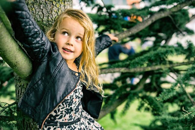 Angeline Coco climbing a tree