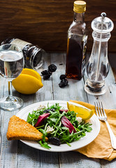 green salad with arugula, beets, goat cheese and p…