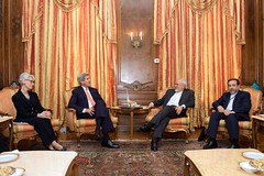 U.S. Secretary of State John Kerry and Iranian Foreign Minister Javad Zarif, flanked by U.S. Under Secretary of State for Political Affairs Wendy Sherman and Iranian Deputy Foreign Minister Abbas Araghchi, chat as they meet in New York, New York, on April 27, 2015, for a talk about Iran's nuclear program on the sidelines of their attendance at the 2015 Review Conference of the Parties to the Treaty on the Non-Proliferation of Nuclear Weapons. [State Department photo/ Public Domain]