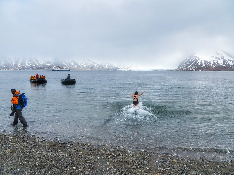 Running into the Arctic ocean in Svalbard, Norway