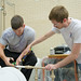 Students David Trudeau (left) and Ian T. Gates work together to finish their Engineering Capstone project.