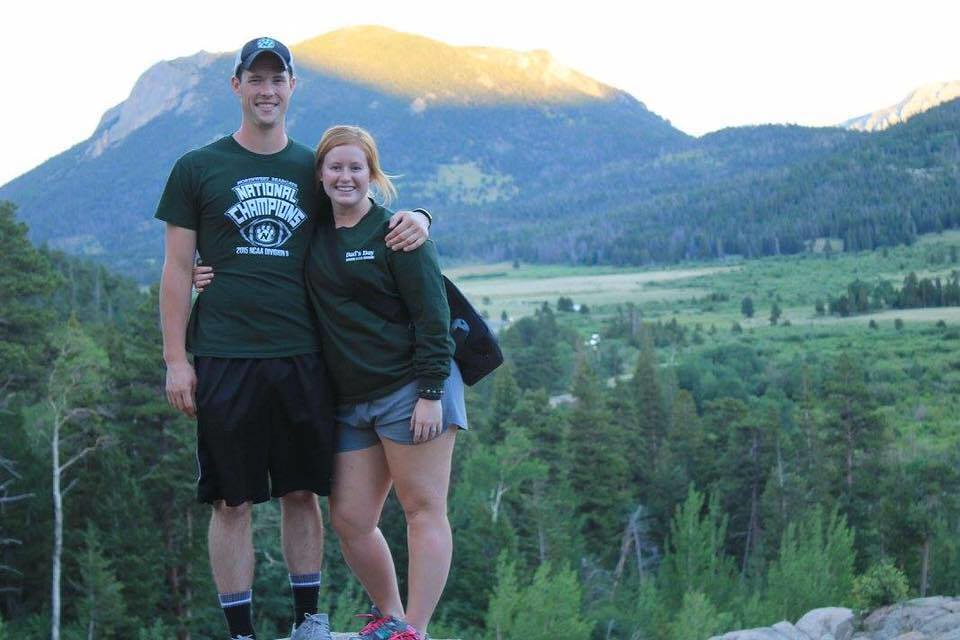 Hayston Wilson and Katie Stevens hiking up a waterfall in Rocky Mountain National Park, Estes Park, CO.