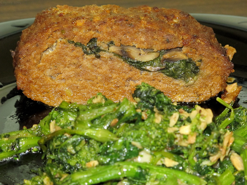 Spinach and mushroom stuffed meatloaf with garlicky broccoli rabe