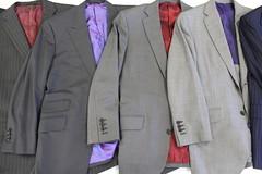 wool(0.0), overcoat(0.0), jacket(0.0), formal wear(0.0), tuxedo(0.0), pattern(1.0), textile(1.0), clothing(1.0), purple(1.0), blazer(1.0), outerwear(1.0), suit(1.0),