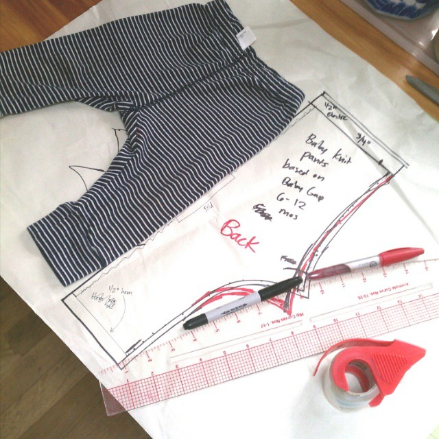 Tracing a pair of knit baby pants to make a #sewing pattern but the perfectionist in me worries the curve will be off by a few millimeters and wishes I hadn't left all my baby patterns at home in Brooklyn. #SHBsewalong #sewingforbabies