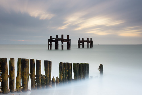 wood light sea sky mist art water clouds sunrise wooden sand long exposure stones pebbles dolphins solent ww2 pluto southampton stucture groynes lepe