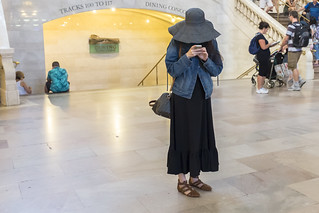 Image of Grand Central Terminal near New York County. cc grandcentralterminal hat indoor manhattan midtown nyc standing trainstation woman wwward0 newyork unitedstates us