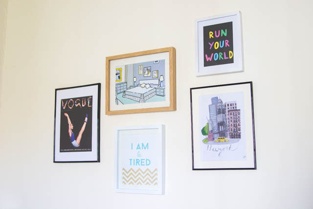 mismatched picture frames on the wall