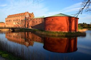 Image of Malmöhus slott. light sky sunlight reflection castle water pond sweden slott malmöhus malmö̈ malmöhusslott