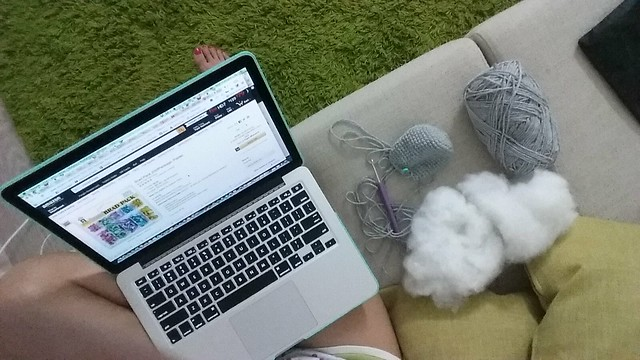 Perched at the favourite corner of my house, with my macbook, crochet needle, yarn and stuffing.