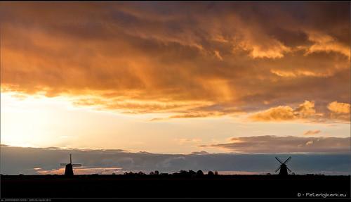 clouds sunrise geotagged nederland wolken windmills wieken molens schermer nld schermerhorn zonsopkomst provincienoordholland peterbijkerkeu langerust korterust geo:lat=5260543721 geo:lon=487097472