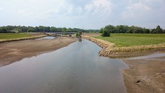 wetland, estuary, floodplain, polder, levee, soil, water, river, body of water, channel, mudflat, canal, rural area,