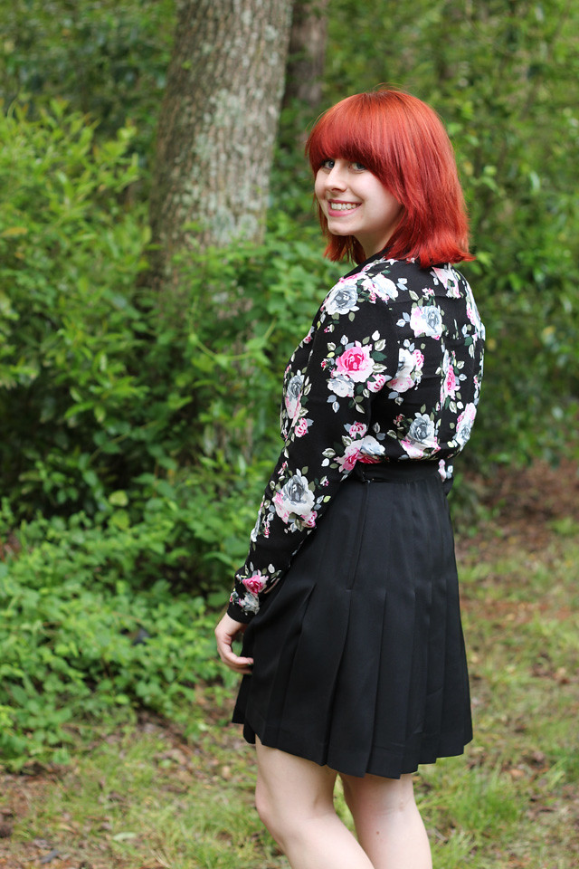 Bright Red Hair, Floral Print Top, and Pleated Skirt