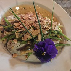 Rainbow trout with green beans and almonds in browned butter at Caprice cafe.