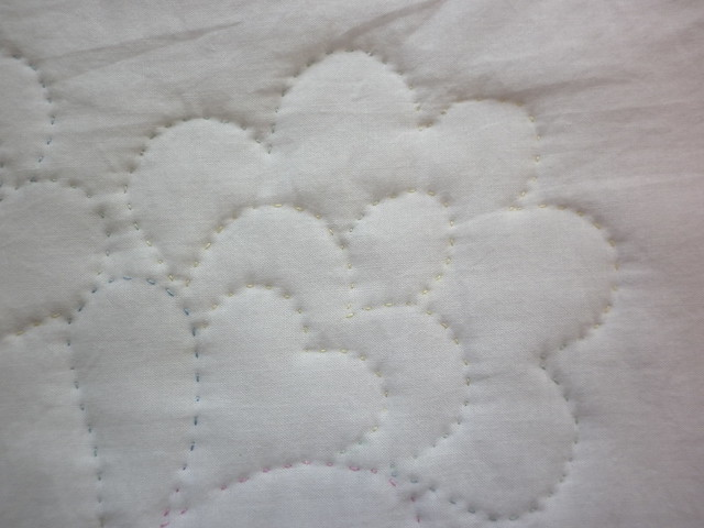 Teeny tiny baby quilt - the back of the hand quilting