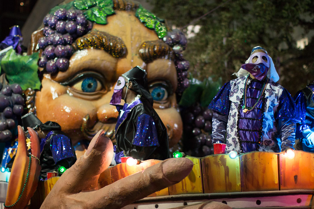 Krewe of Bacchus from Lafayette Hotel grandstands during Mardi Gras