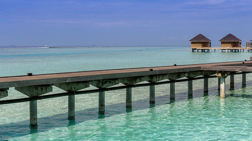 ocean travel blue sunset sea summer vacation sky house beach nature water clouds sunrise relax landscape island sand paradise bluesky palm resort exotic tropical maldives goldenhour atoll watervillas