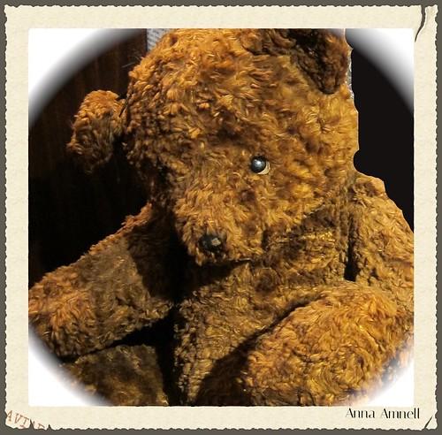 a teddy bear in an a cafe