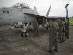 Lt. Cmdr. Jeff Pinkerton, an EA-18G Grolwer pilot assigned to Electronic Attack Squadron (VAQ) 138, speaks with a group of Philippine Air Force pilots assigned to Clark Air Base, Philippines. (U.S. Air Force/Capt. Elias Zani)