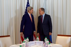 U.S. Secretary of State John Kerry chats with Russian Foreign Minister Sergey Lavrov before they take their respective seats for a bilateral meeting on August 26, 2016, at the President Wilson Hotel in Geneva, Switzerland. [State Department photo/ Public Domain]