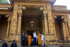 U.S. Secretary of State John Kerry talks with a monk at the Kelaniya Temple in Colombo, Sri Lanka on May 2, 2015. [State Department Photo/Public Domain]