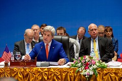 U.S. Secretary of State John Kerry, backed by members of his delegation, delivers opening comments to his fellow Ministers at the National Convention Center in Vientiane, Laos, on July 25, 2016, at the outset of a Lower Mekong Initiative Meeting on the sidelines the annual meeting of the Association of Southeast Asian Nations (ASEAN). [State Department/ Public Domain]