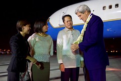 U.S. Secretary of State John Kerry admires a traditional lei presented to him by Filipino Protocol officials on July 26, 2016, at Villamor Airport in Manila, Philippines, after he arrived for a visit that will include meetings with newly elected President Rodrigo Duterte and Foreign Secretary Perfecto Yasay. [State Department Photo/ Public Domain]