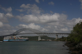 Container ship passing under the Bridge of the Americas.  Panama City.