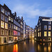 View of famous amsterdam canal by night