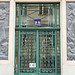 Relief sculptures and ornate green door grille - Vienna by Monceau